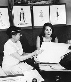 Natalie Wood's eyes grow large with excitement over designer Edith Head's new sketches