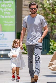 Scott Disick wearing Saint Laurent Hedi Jodhpur Boots, Saint Laurent Original Low Waisted Skinny Jean in Washed Grey Stretch Denim and John Elliott Classic Crew