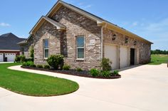 A 3 CAR GARAGE gives this home lots of STORAGE space for more than just cars!