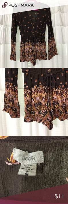 """Ecote Floral Festival Romper Urban Outfitters Ecote plum colored floral romper in good condition. Has one button missing (please see pictures). Size small. Armpit to armpit: 17"""". Inseam: 2"""" Ecote Dresses"""