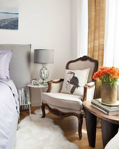 plush headboard combined with the vintage chairs and wooden accents
