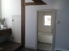 My little under the eaves bedroom. A two-tone color scheme, beams and plenty of wood! Eaves Bedroom, Cottage, Attic, Beams, Color Schemes, Mirror, Wood, Furniture, Home Decor