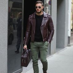 Consider teaming an oxblood quilted leather motorcycle jacket with olive green cargo pants to create a great weekend-ready look. Shop this look on Lookastic: https://lookastic.com/men/looks/biker-jacket-crew-neck-t-shirt-cargo-pants/20806 — Black Sunglasses — Black Crew-neck T-shirt — Burgundy Quilted Leather Biker Jacket — Burgundy Leather Messenger Bag — Olive Cargo Pants — Silver Watch