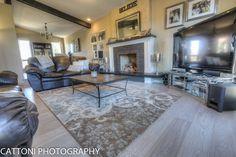 The living room of this beautiful Home features Lauzon Flooring Fifth Avenue Wire Brushed hardwood flooring from the Urban Loft Series. #interiordesign #hardwoodfloor #artfromnature #livingroom