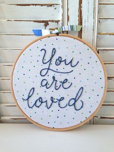 embroidered hoop art . you are loved . embroidery hoop . wall . inspirational . nursery decor . confetti . cotton . home . hand embroidery