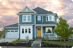 Exterior Paint Colors: *Door – Butterfield by Sherwin-Williams *Exterior Main: Riverway by SW *Accent: Escape Gray by SW *Trim: Snowbound by SW