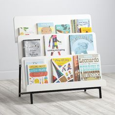 Shop New Issue Modern Bookcase (White/Black Base). Our New Issue Modern Bookcase (White/Black Base) featuring a three-tier design that allows the books to display forward facing. White Bookshelves, Modern Bookcase, Bookshelves Kids, Bookshelf Ideas, Bookcases, Book Racks, Kids Furniture, Garden Furniture, Painted Furniture