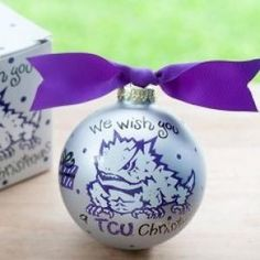 Any fan will love this TCU We Wish You Ornament. Personalize it with a name and date for a special holiday keepsake. All collegiate ornaments come boxed and tied with a coordinating ribbon making them the perfect gift for anyone.