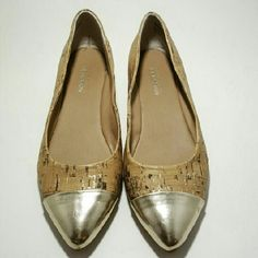 Cap toed cork flats Sz 7, EUC. Cork flats with metallic silvers cap toes. No real damage...a couple tiny, nearly impossible to photograph scratches at toes (pic 4). Kenneth Cole Reaction Shoes Flats & Loafers