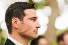 Groom watching his bride walk down the aisle. wedding. groom. Josh Elliott Photography. joshelliottstudios.com