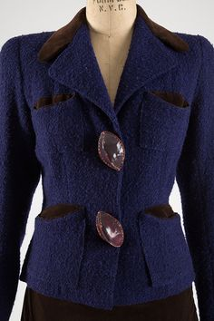Elsa Schiaparelli suit with leather buttons, Fall 1936. Via the collection of The Museum at FIT.