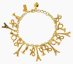 This Parisian Lights Charm bracelet by Kate Spade for $39 (originally $88) immediately charmed (pun slightly intended) me.  See http://eyeforelegance.com/2014/02/11/kate-spade-surprise-sale/ for more details.