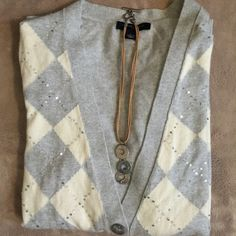 Banana Republic Argyle Cardigan Grey and ivory argyle sweater with silver sequins- made up of 55% cotton, 20% Polyester, 20% Nylon, and 5% rabbit hair- size L -  don't recall wearing if so only once- white shirt sold separately on another listing Banana Republic Sweaters Cardigans