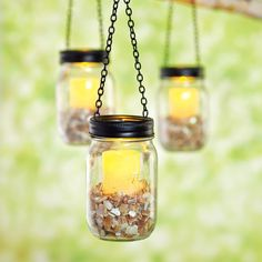 Give your garden or patio gorgeous glowing light with these trendy Hanging Mason Jar lights. Wit...