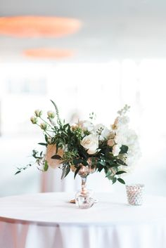 White & Green Centrepiece Design: Celsia Floral  Christine Pienaar Photography