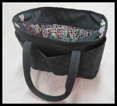 Looking for a diaper bag pattern for a friend's new little one.  This one looks good.