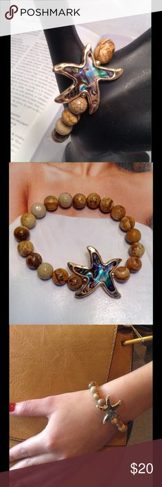 Starfish Wood Bracelet Gorgeous abalone starfish set with wood beads on stretch setting. Beautiful piece! Price firm unless bundled. (Closet does not trade) Boutique Jewelry Bracelets