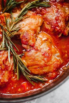 Pollo in Potacchio is an Italian braised chicken dish made with tomatoes, rosemary and garlic. The chicken cooks until it's fork tender, which is great served with pasta, noodles or polenta.