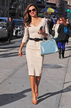 Miranda Kerr put a modern spin on classic style — looking glamorous as ever — in a cream-colored Victoria Beckham dress accessorized with a light-blue Prada tote, Lanvin heels, and Miu Miu sunglasses.