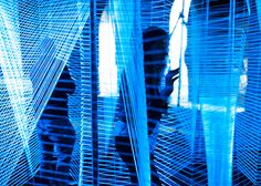 Called Lasermaze, this installation by George King consists of ultra-violet string woven through steel chains.
