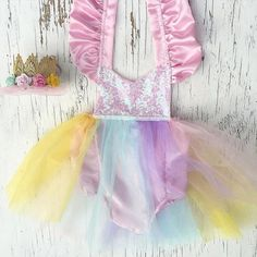 A Magical Unicorn #sparkleromper is the perfect outfit for your babe's unicorn birthday ✨ Crown by @lovecrushbowtique  Order this tutu #sparkleromper at bellethreads.com