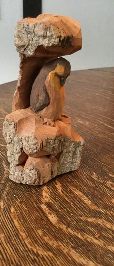 Penguin under a ledge. Cottonwood bark.  5x3x2.  1.3