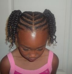 Cornrowed ponytails with two strand twists, so cute!
