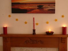 Handmade Christmas Decorations : Beeswax Star Bunting. Waldorf Beeswax Star Bunting    You will need:    Beeswax sheets  A hammer  Star-shaped cookie cutter  String  Candle for dripping wax    so pretty and i bet it smells great!