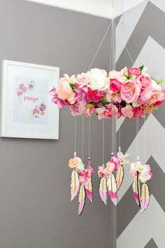 Floral mobile/ love the flowers above the feather dream catcher mobile!Beautiful..