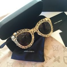 D&G Filigree Gold Sunglasses  Antiqued gold coloured filigree sunglasses, a perfect blend of elegance, femininity and lightness.  Decorated with metal flowers distributed across the front and temples. Brown gradient lenses. Measurements : 47-26-140. Dolce & Gabbana Accessories Sunglasses