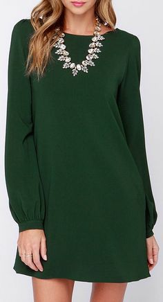 You'll be primed and ready in the Perfect Situation Dark Green Long Sleeve Shift Dress when everything starts falling into place! This woven poly dress has a casual shift shape, accented by a rounded neckline and long sleeves with lightly puffed shoulders. Sleeves end with shining gold button tabs on the fitted wrist cuffs. #lovelulus