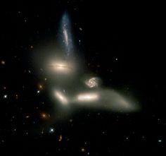 Cosmic Dance of Destruction   ESA/Hubble