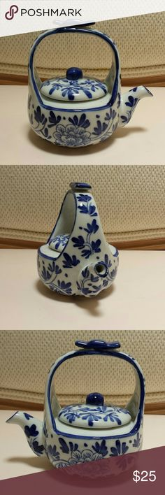 Decorative Blue and White Teapot Still in beautiful condition.  Measures at 4 inches high by 4 1/2 inches wide (including spout) by 3 inches in depth.   No trades.   Please submit any offers though the offer option. Accessories