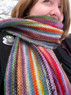 Free Knitting Pattern for Mini Mania Scarf - Colorful scarf knit with mini skeins of sock weight yarn in linen stitch to get a woven effect. Perfect for your leftover scraps of yarn.4 sizes. Designed by Sarah Core