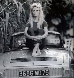 Brigitte Bardot sitting on a Renault Floride.