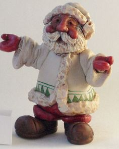 This four inch polymer clay Santa was sculpted around an armature, cured, carved for added detail and finally painted with acrylics. ~ by Colleen Mize