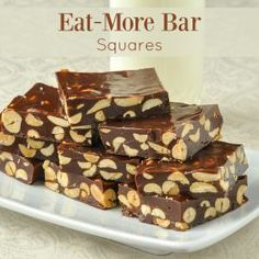 Eat-More Bar Squares - an easy candy confection! Eat-More Bar Squares - an easy candy confection! These chewy, crunchy candy squares are the perfect marriage of peanut and chocolate flavours. Rock Recipes, Candy Recipes, Baking Recipes, Cookie Recipes, Dessert Recipes, Desserts, Bar Recipes, Cheesecake Recipes, Delicious Recipes