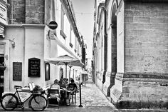 The Alley in the streets of Valletta Malta. This is an artwork in black and white portraying one of the typical roads in the capital city of Malta. Capital City, Malta, Black And White Photography, Knights, Roads, Restoration, Bicycle, Culture, Fine Art