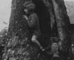 The real Christopher Robin Milne and is toy bear.