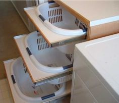 Laundry room ideas. This would totally work for sorting recycling, etc.