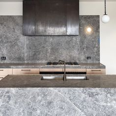 Hecker Guthrie Kitchen design, love the metal range hood