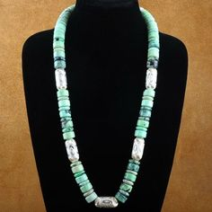 This handmade necklace is inspired by the Old West styles of Native American jewelry. Genuine Chrysotine flattened discs in assorted sizes are complemented with diamond cut Silver plated barrel beads for a festive flair! The natural colors of the Chrysotine come alive in this hand strung necklace. A beautiful mottled green in lighter to darker tones with inclusions of black and grey specks throughout. Designed and hand strung in our shop by Navajo, Sherry Blackgoat #144.00 #Alltribes