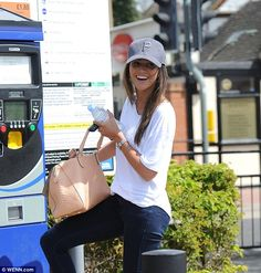 Relaxed style: The 28-year-old actress looked in high spirits as she paid for her parking before hitting some of her local shops, the beauty keeping her outfit uncharacteristically pared-back for the trip