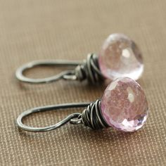 Sparkling plump pink quartz briolettes are wrapped with sterling silver wire in these versatile and easy to wear earrings.