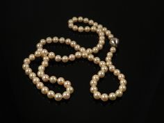 A pearl necklace with 9ct white gold clasp in original case