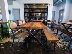 Reclaimed wood dining Table with steel X frame by UrbanWoodGoods