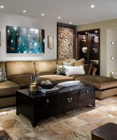 Design by Candace Olson - basement, browns and greys - warmth provided by cut wood feature, shelving and painting. Cozy.
