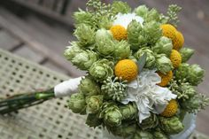 Bridal bouquet, hops and craspedia - how adorable is this??? #wedding