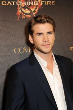 Liam Hemsworth and Getty Images at event of The Hunger Games: Catching Fire