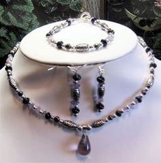 Amethyst teardrop and pearls - 3 piece set    Manufacturer: N/A  SKU: T109  Price: $33.00  This item is in stock